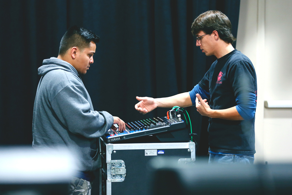 CRAS student & faculty member during a proficiency test in the Live Sound Venue at the CRAS GIlbert satellite campus.